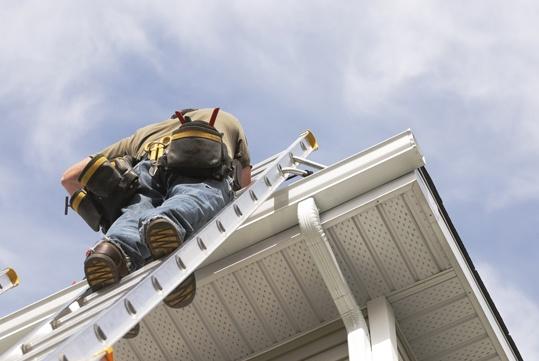 Man on Ladder Working on Rain Gutter Quality Architectural Metal & Roofing Birmingham Al